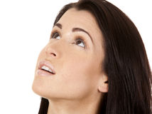 Brunette looking up. Close up on brunette's face as she is looking up Royalty Free Stock Image