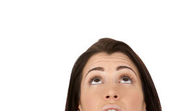 Brunette looking up. Close up on brunette's face as she is looking up Royalty Free Stock Photos