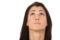 Brunette looking up. Close up on brunette's face as she is looking up Stock Photos