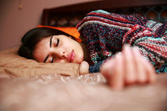 Brunette lying on bed sleeping at home Royalty Free Stock Images