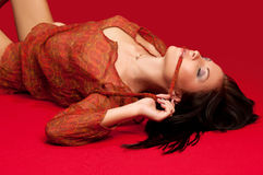 Brunette lying on the floor Royalty Free Stock Image