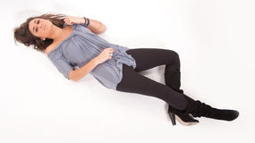 Brunette lying on the floor Royalty Free Stock Photography