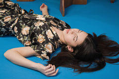 Brunette lying on the floor in a luxury room Stock Photos
