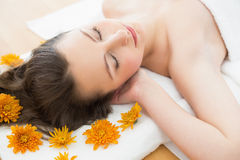 Brunette lying on massage table in beauty salon Stock Photography
