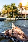 girl lying in a sailing catamaran stock photography