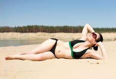 Brunette lying in the sun Stock Photo