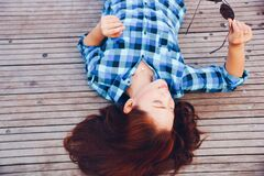 Brunette lying on wooden deck