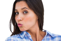 Brunette making kissing face at camera Royalty Free Stock Photos