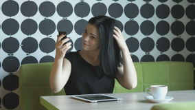 Brunette making selfie photo using a mobile phone stock video