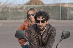 Brunette man with brown leather jacket on a motorbike royalty free stock photography