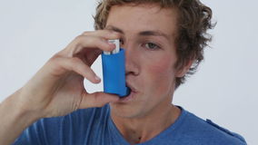 Brunette man having an asthma attack Stock Photo