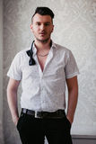 Brunette man with stubble wearing a white shirt Royalty Free Stock Photo