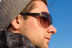 Brunette Man With Sunglasses And A Hat Looking Stock Photos