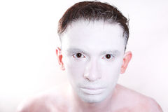 Brunette man with white makeup on skin close up Royalty Free Stock Photography