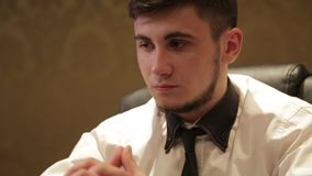 Brunette man in white shirt playing poker stock video footage