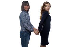 Brunette man and woman with pair of handcuffs Royalty Free Stock Photos
