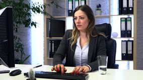 Brunette manager works in the office with documents. And drinks water stock video footage