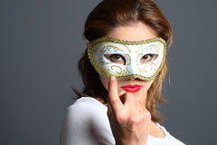 Brunette with mask Stock Photography