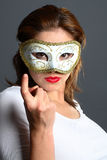 Brunette with mask Royalty Free Stock Photo