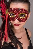 Brunette in mask. Mysterious brunette wearing carnival red mask on her face Royalty Free Stock Photography