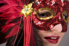 Brunette in mask. Mysterious brunette wearing carnival red mask on her face Stock Image