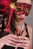 Brunette in mask. Mysterious brunette wearing carnival red mask on her face Royalty Free Stock Images