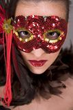 Brunette in mask. Mysterious brunette wearing carnival red mask on her face Royalty Free Stock Image