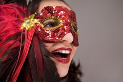 Brunette in mask. Mysterious brunette wearing carnival red mask on her face Stock Photo