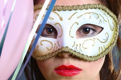 Brunette with mask closeup Royalty Free Stock Images