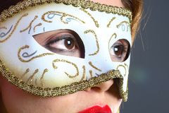 Brunette with mask closeup Royalty Free Stock Photo