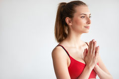 Brunette meditating with hands together Royalty Free Stock Photo