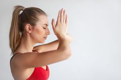 Brunette meditating with hands together Royalty Free Stock Image