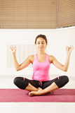 Brunette at meditation process Royalty Free Stock Image