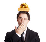 Brunette men with present box over head. Royalty Free Stock Photos
