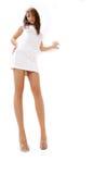 Brunette met lange benen stock afbeelding