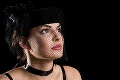 Brunette met netto hoed royalty-vrije stock afbeeldingen