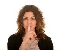 Brunette met vinger op gezicht Royalty-vrije Stock Foto's