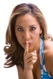 Brunette mit dem Finger auf Gesicht Lizenzfreies Stockbild