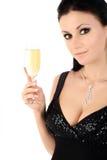 Brunette mit einem Champagnerglas. stockbild