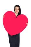 Brunette mit Herzen stockbild