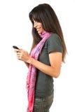 Brunette mit Mobile lizenzfreie stockfotografie