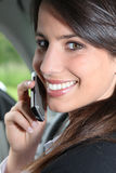Brunette on a mobile in a car Stock Photography