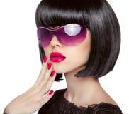 Brunette Model in fashion sunglasses. Beautiful glamour woman wi Stock Photo