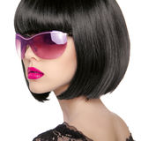 Brunette Model in fashion sunglasses. Beautiful glamour woman wi Stock Images