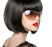 Brunette Model in fashion sunglasses. Beautiful glamour woman wi Stock Image