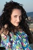 Woman flipping hair. Brunette model flipping long hair backwards Royalty Free Stock Images