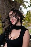 Woman flipping hair. Brunette model flipping long hair backwards Royalty Free Stock Photo