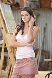 Brunette Model In Front of Artist Easel Royalty Free Stock Photo