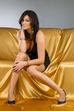 Brunette Model In A Gold Dress Royalty Free Stock Photography