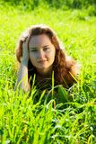 Brunette model laying in meadow Stock Photos